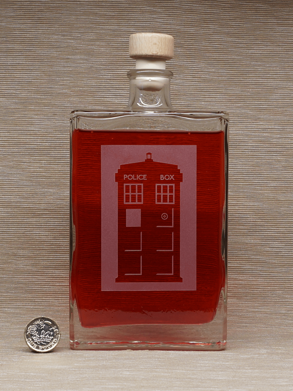 Cranberry gin in Police Box bottle