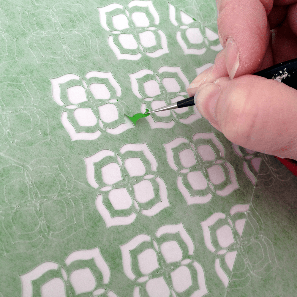 Using a hook to weed a stencil | Photo by realitydaydream.com
