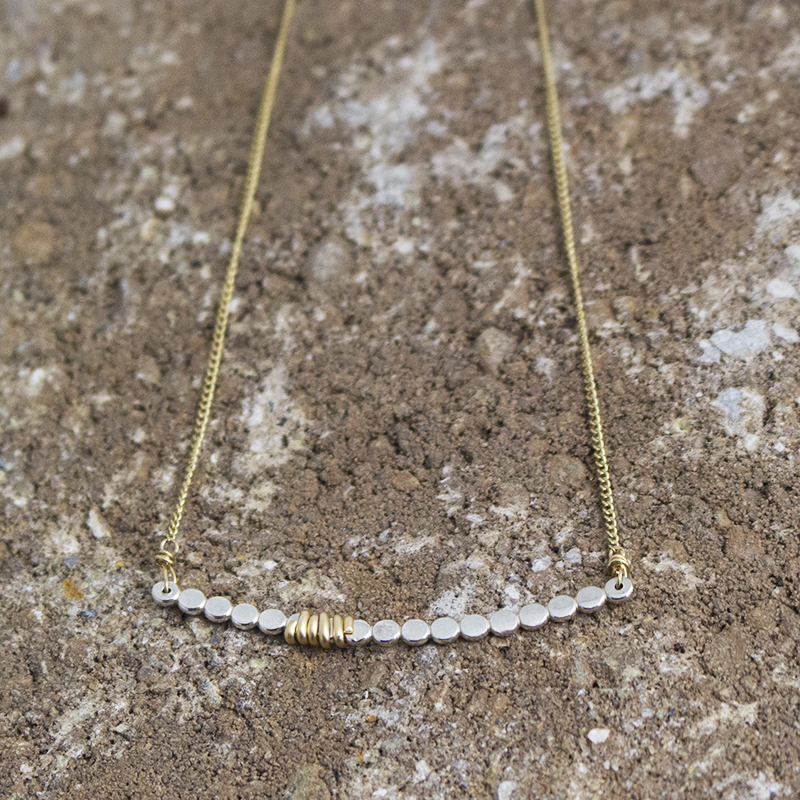 Simple, yet striking necklace in sterling silver and 14k gold fill.