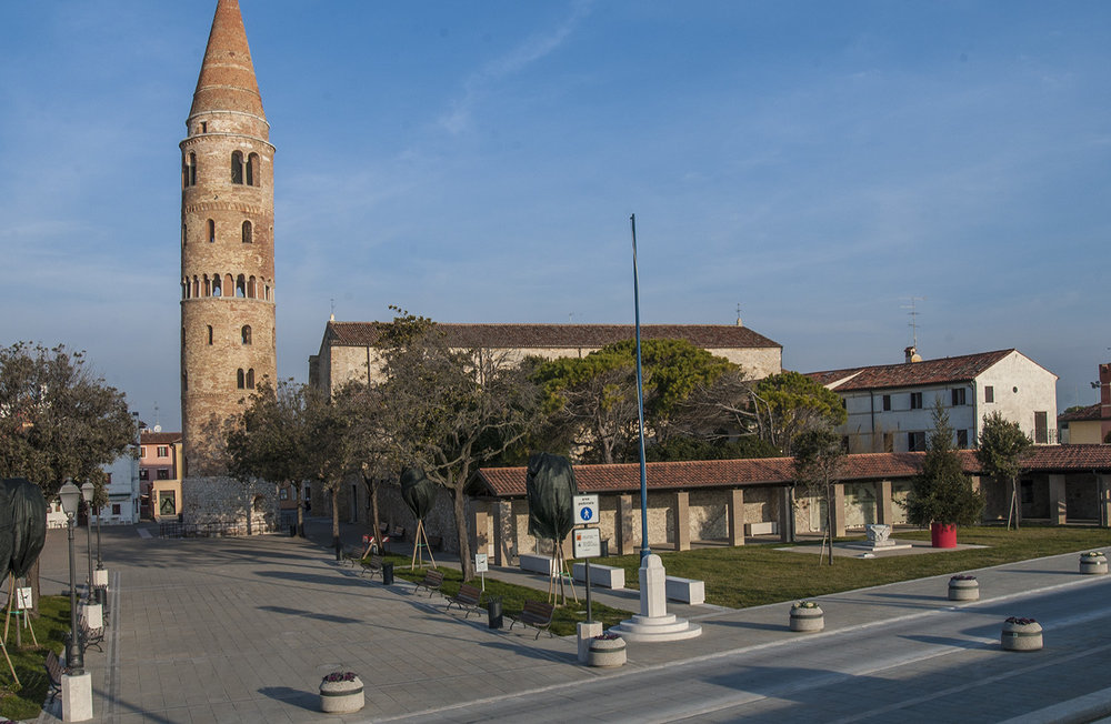 Campo del Duomo with the bell tower in front of the Cathedral