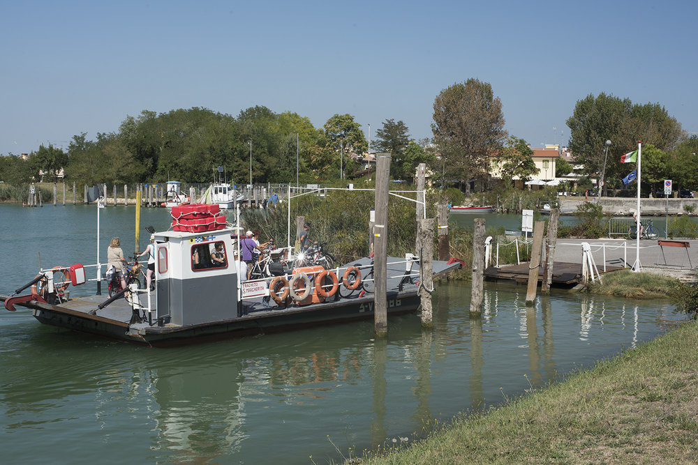 The car/pedestrian traghetto (ferry) arriving on the Porto Santa Margherita (Caorle side in the background)