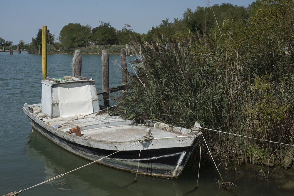 AS17-01912 Old fishing boart moored next to the traghetto, Porto Santa Margherita, Veneto