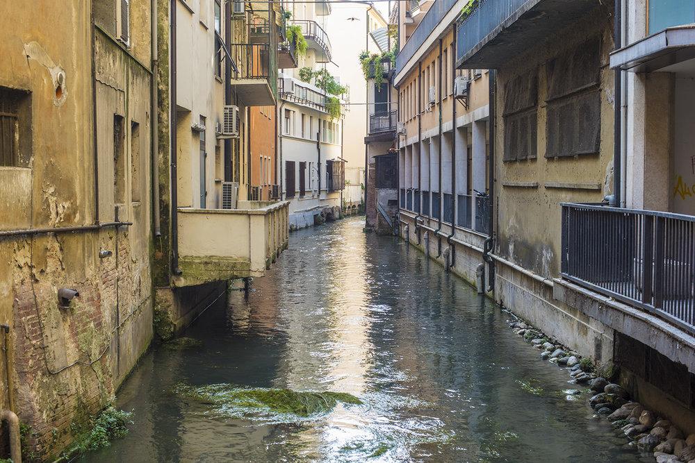 AS17-02022 Small river running through Treviso, Veneto