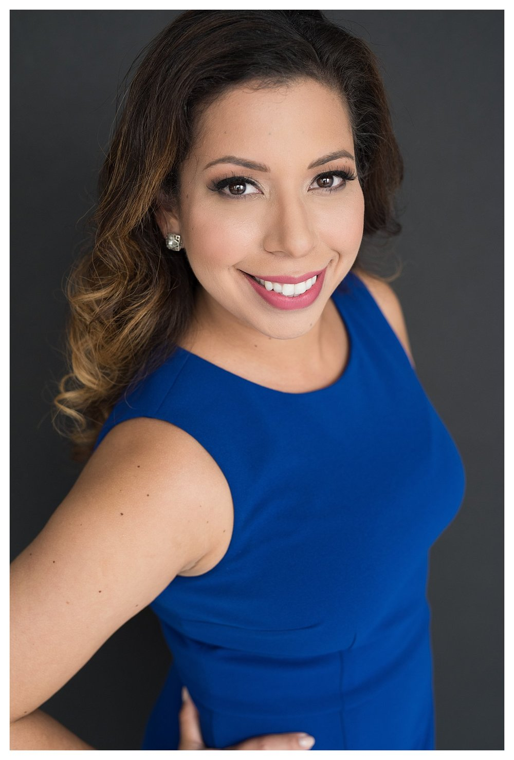 """Professional photographer tip: I photographed Adrienne out of focus from the shoulders down so that the focus was on her eyes. I also made sure there was a bright """"catch light"""" in the eyes so her eyes pop. This creates trust with potential clients viewing the image."""