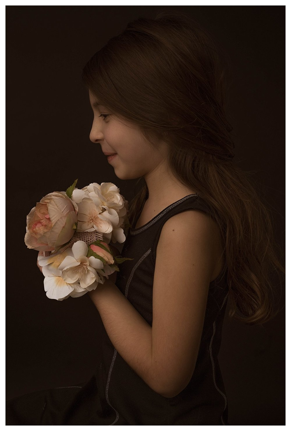 little-girl-with-flowers-portrait-daughter-pictures-ideas-poses-san-antonio-photographer.jpg