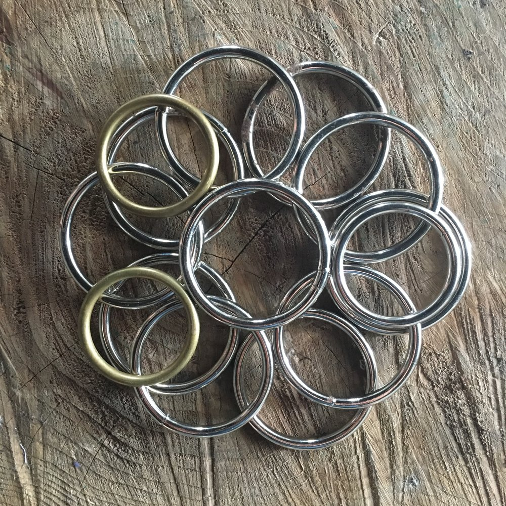 Close-up of aluminum rings used during the performance. Photo by Daniel Addy.