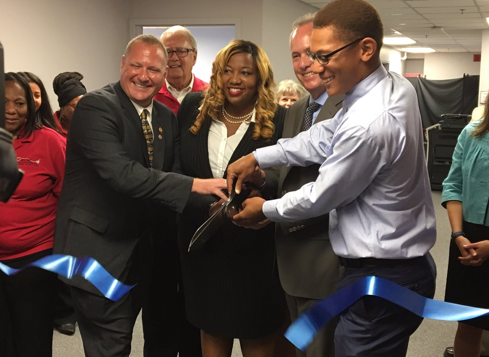 Clients and staff of the KCAC join Mayor Fischer to cut the ribbon of the new KCAC location.