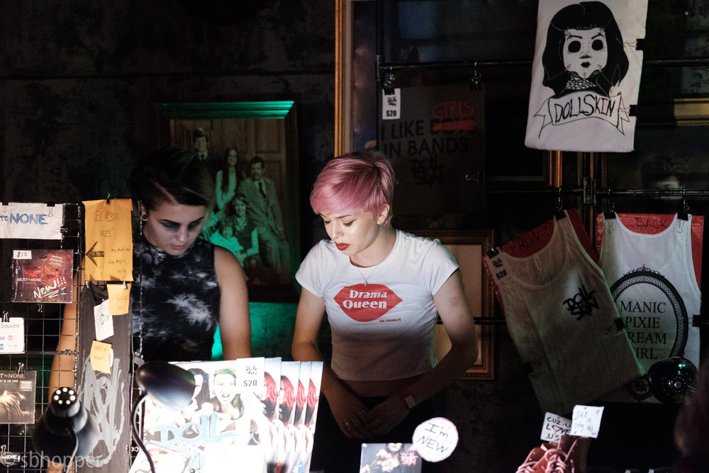 Last minute checks on the merchandise. Doll Skin, Chop Suey, Seattle, 17 August 2017. (Chop Suey has some of the best, craziest wall art.)