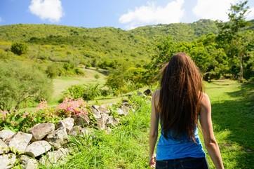 Woman walking in rural landscape