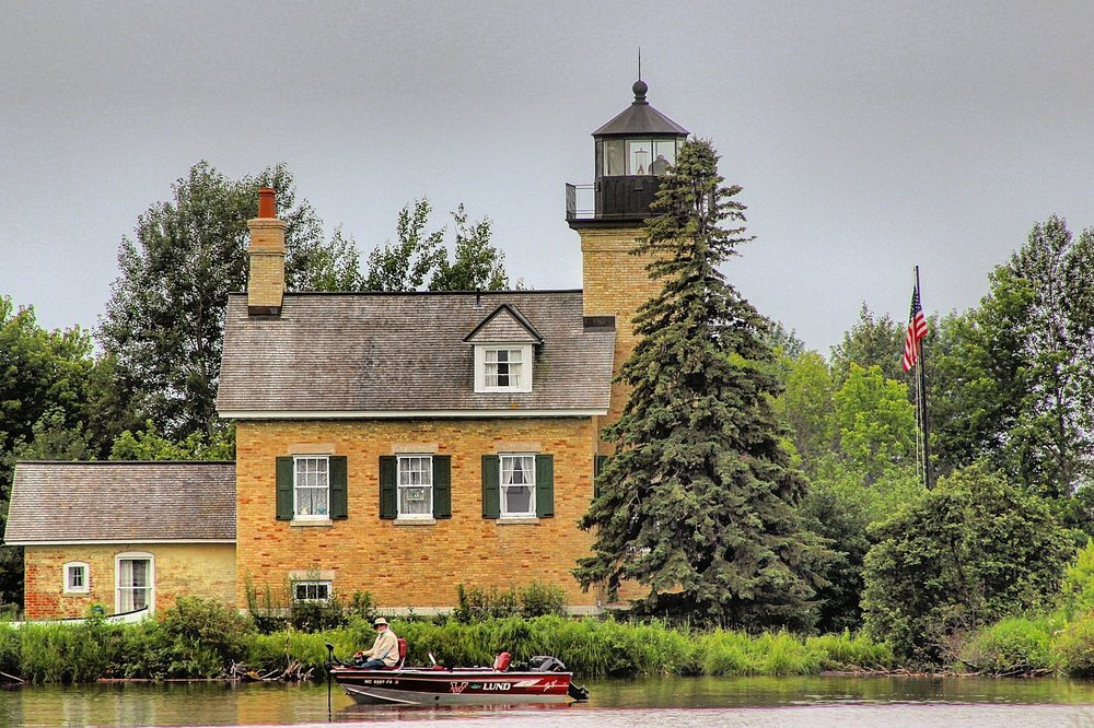 Ontonagan, Michigan lighthouse, local angler in foreground