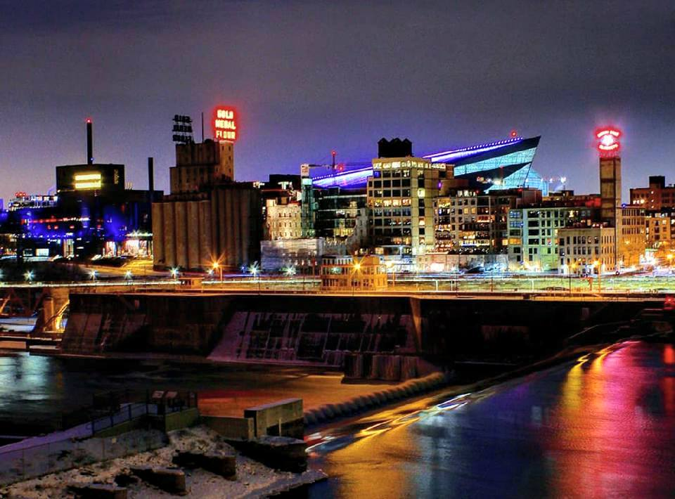 nighttime view of the Mill District and Mississippi