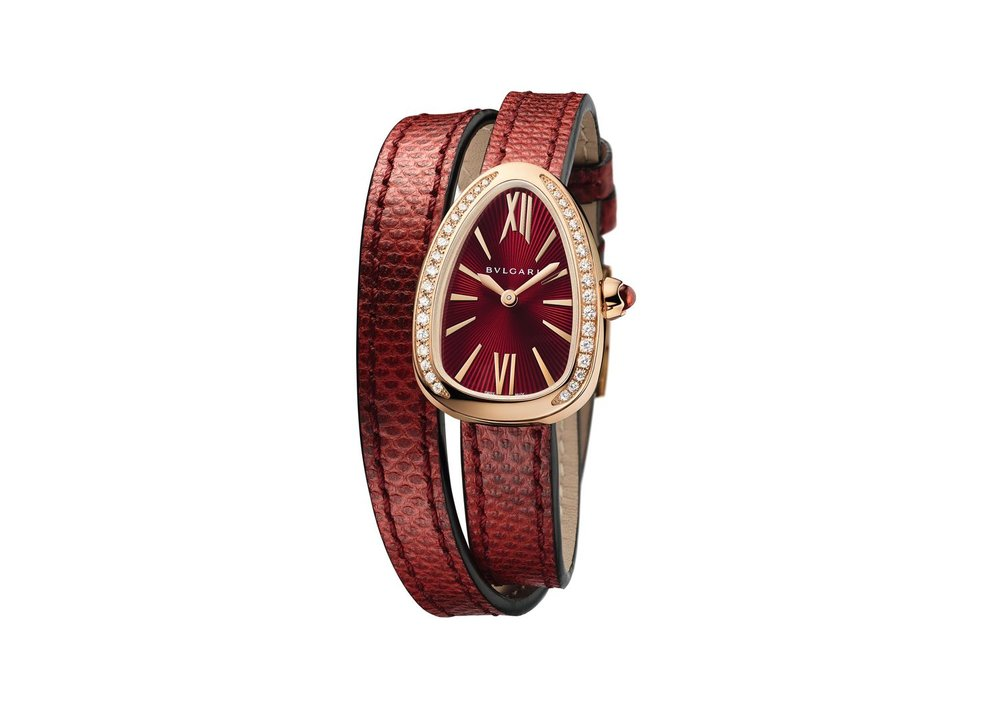 Watch, Serpenti, 27 mm, Case Gold 5N 18kt 750, Dial Red, Bracelet Serpent Karung (Source of leather, Indonesia-Thailand - Latin name, Acrochordus Javanicus - Origin, wild), Bracelet colour Red, Hour-minute, Quartz, Diamonds-Stones, Partial setting, Diamonds 34 pce, Stones 1 pce, Weight diamonds 0.3 [ct], Weight stones 0.108 [ct], Weight precious metal 22.8 [g], Waterproof 50 [m], Crown with Rubellite. Comes with an additional strap. Different colors available.