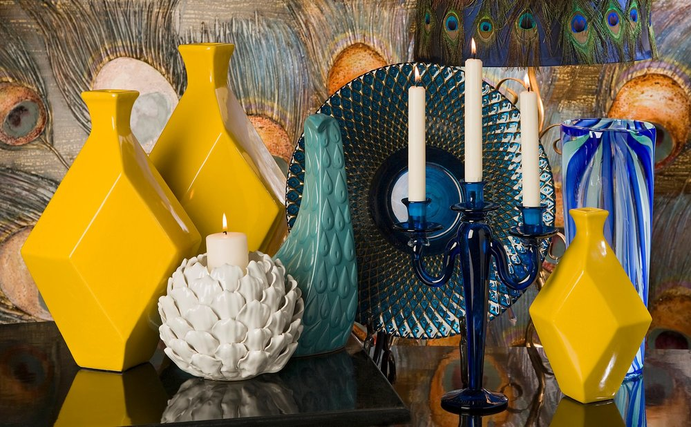 TABLETOP - The grouping of objects is an ideal way of putting the entire color scheme of your space together. It also adds balance and a commonality to the area that showcases for example a piece of art or anchor, like a fireplace.