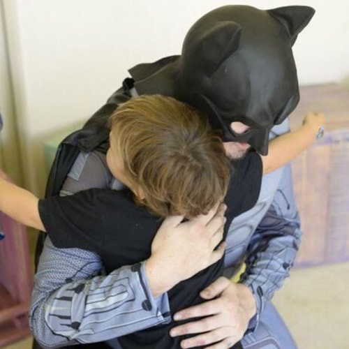 Character Batman Pampering a Child in Kids Party
