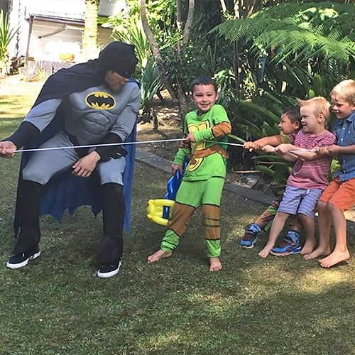 Character Batman in Playing with Childrens