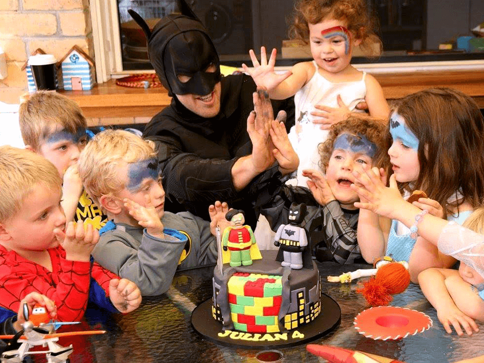 US AKP Party Pics (H) - Batman at Party High Five.png