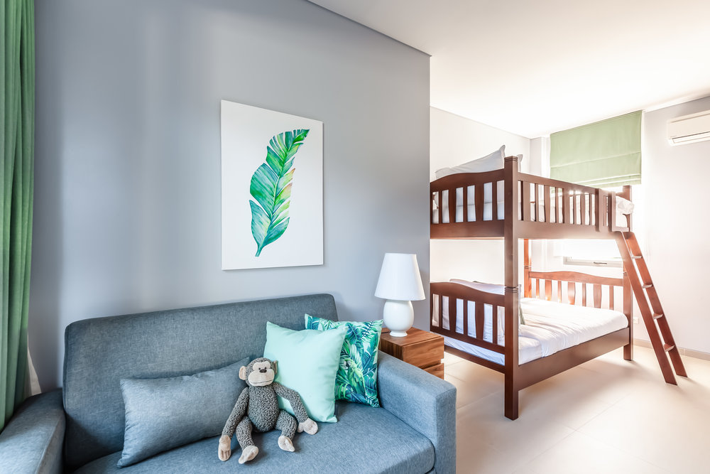 Guest Room - 1 Room - The best way for parents to have a good night's sleep is when the kids have their own room. The full size bunkbeds can comfortably sleep two adults and the convertible couch-bed an additional person. This room also has its own bathroom