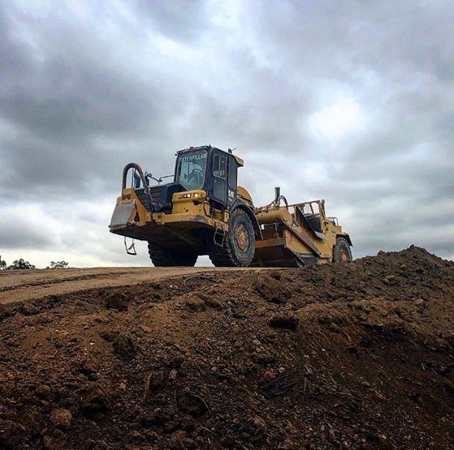 Perfect picture of one of our Scrapers on an overcast day 👌. . Western Earthmoving is a leading civil contractor in the Sydney Civil Construction market. Give us a call for any project, we take on projects of any size. We deliver as promised. . . . #WEM #earthmoving #earthmovingdaily #earthmovingequipment #earthmovingmachinery #earthworks #cuttofill #smellofdiesel #burningdiesel #dozer #scraper #excavator #dumptruck #civilengineering #civilcontracting #civilconstruction #plantoperator #plantoperatorlifestyle #theresrocktoberipped #bulkearthworks #humpday🐫