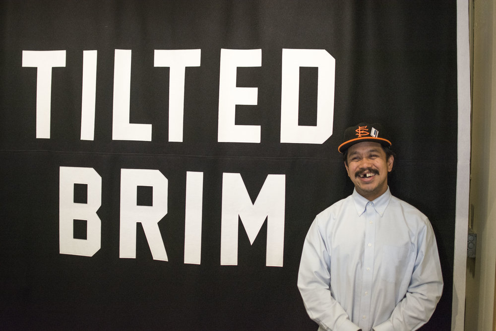 Justin, the owner of the Tilted Brim
