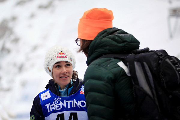 Hendrickson consults with U.S. coach Paolo Bernardi at the 2013 ski jumping championships // photo courtesy Sarah Brunson and  U.S. Ski Team