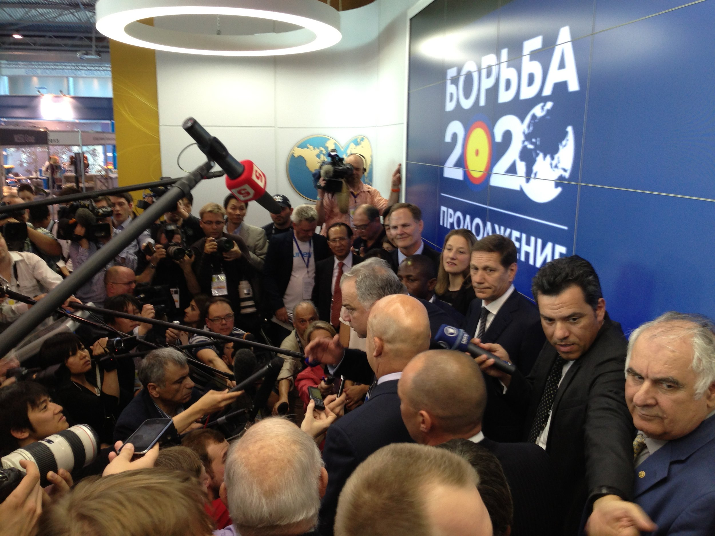 Jubilant wrestling officials meet the press after Wednesday's IOC executive board vote