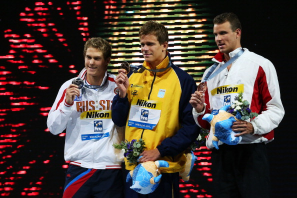 Men's 50 free medalists Vlad Morozov, Cesar Cielo and George Bovell on the medals stand // Getty Images