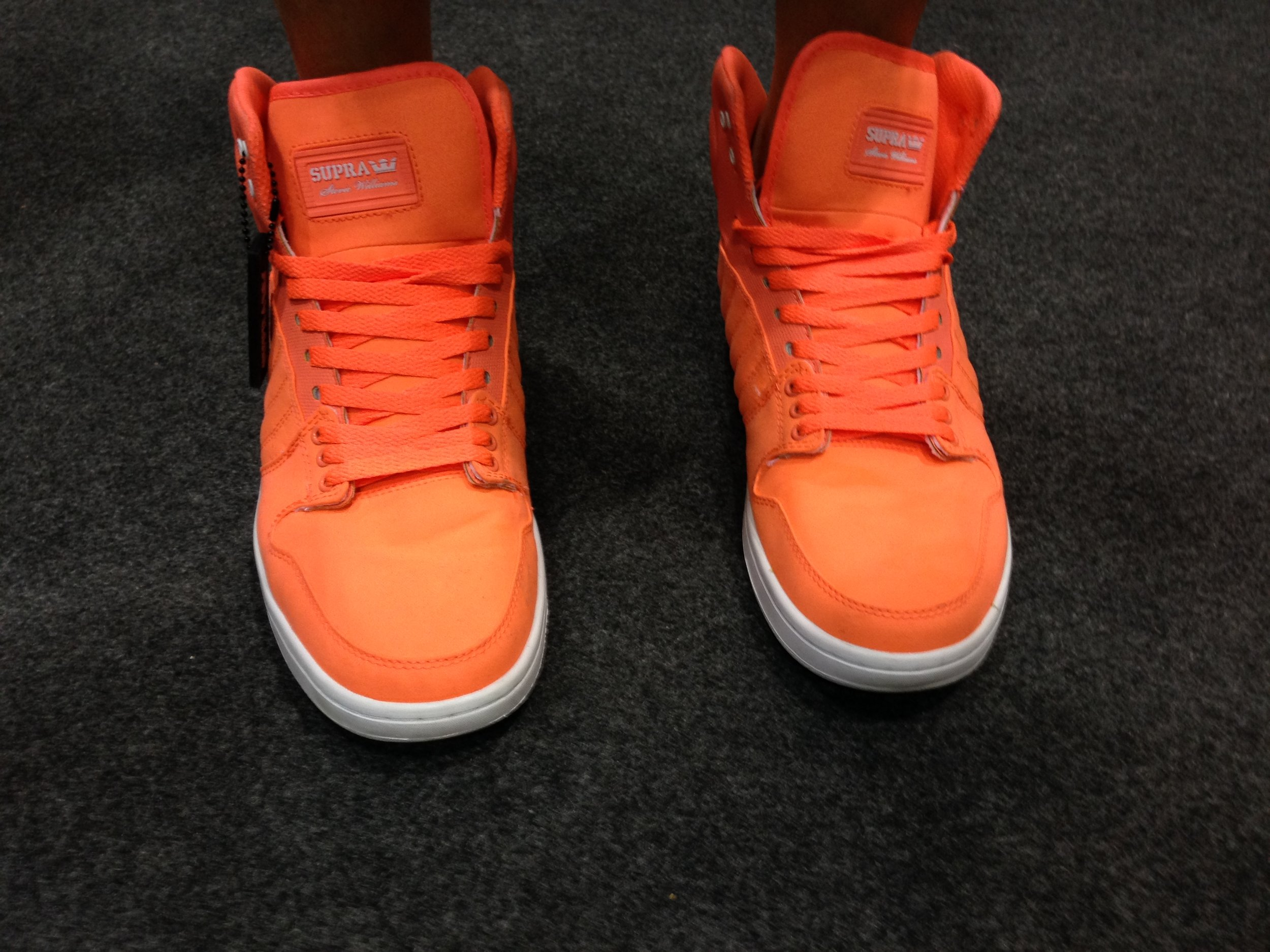 The end: the victory orange high-tops Lochte wore to the news conference after the epic triple