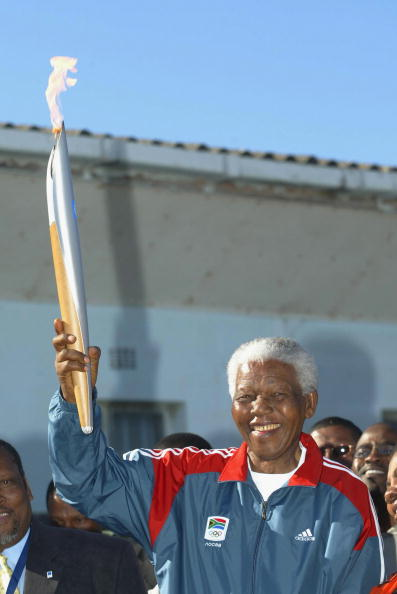 June 2004, the Athens Games relay: Nelson Mandela with the Olympic flame on Robben Island //  photo: Getty Images