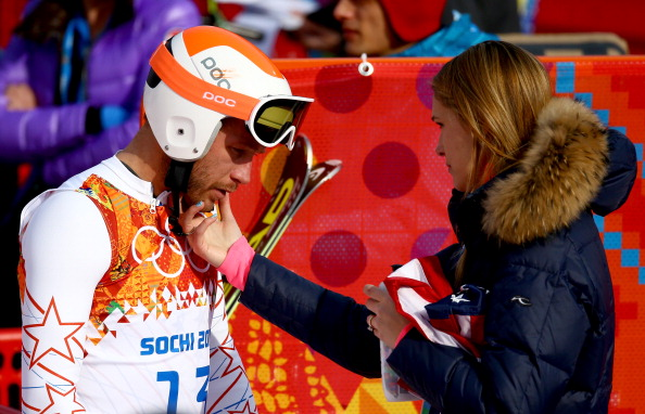 Morgan Miller, right, comforts her husband Bode in the finish area after Sunday's super-G // photo Getty Images