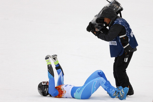 The camera catches Tina Maze making snow angels in victory after the second of her two giant slalom runs // photo Getty Images