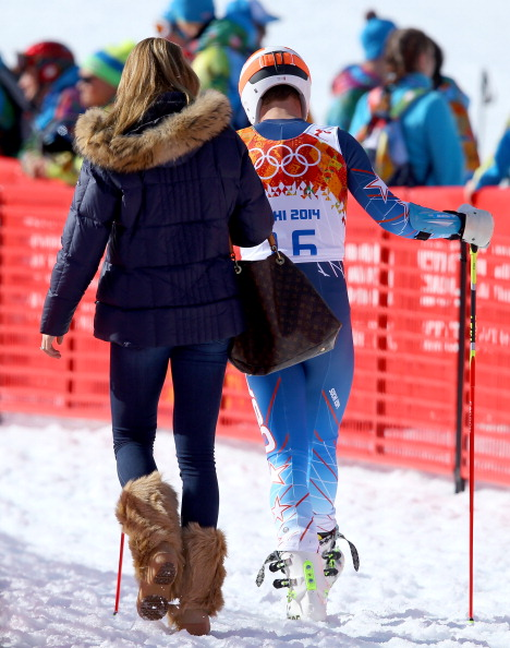 Bode Miller and his wife Morgan leave the course after the men's giant slalom, his last race at the 2014 Sochi Games // photo Getty Images