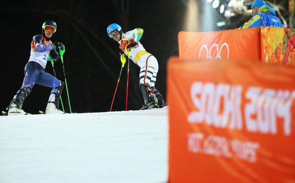 Ted Ligety, left, and Germany's Felix Neureuther after crashing out in Run 2 of the slalom // photo Getty Images