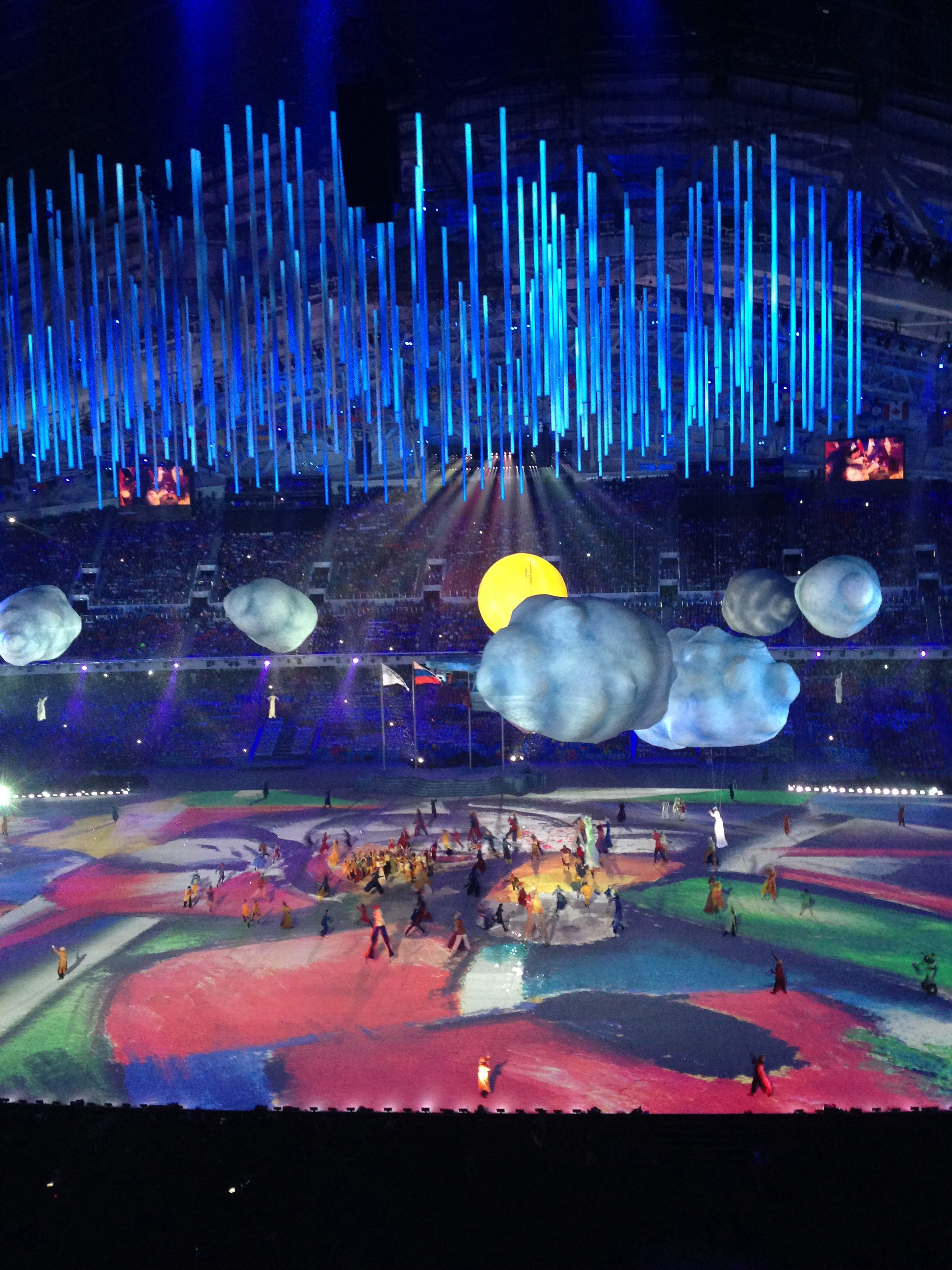 A tableau from the closing ceremony -- brides hanging from helium-filled balloons