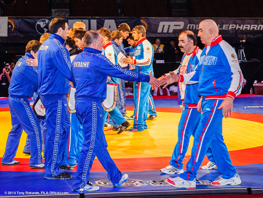 Ukrainian and Russian wrestlers and team officials meet before action gets underway at the LA World Cup // photo courtesy Tony Rotundo, FILA-Official.com