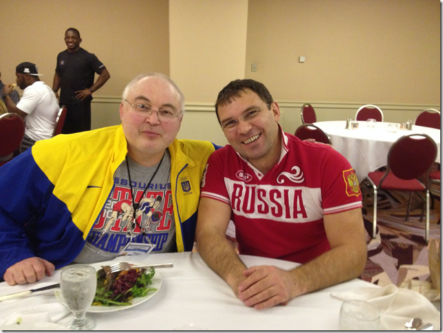 eam leaders Christakis Alexandridis of Russia (right) and Eduard Nosadchyy of Ukraine shares smiles over dinner in the Team Dining Room, prior to the 2014 FILA Men's Freestyle World Cup of Wrestling. // photo courtesy USA Wrestling