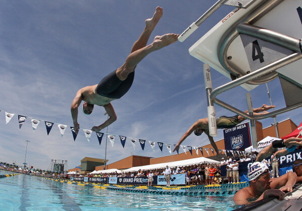 Michael Phelps diving in for his first race back -- over Ryan Lochte, who would go on to win the 100 fly final later Thursday night // photo Getty Images