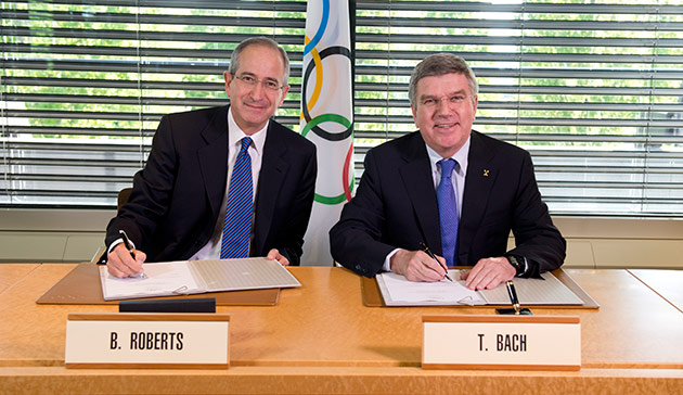 Brian L. Roberts, chairman and CEO of Comcast, and IOC president Thomas Bach, signing the $7.75 billion deal // photo courtesy IOC/Arnaud Meylan