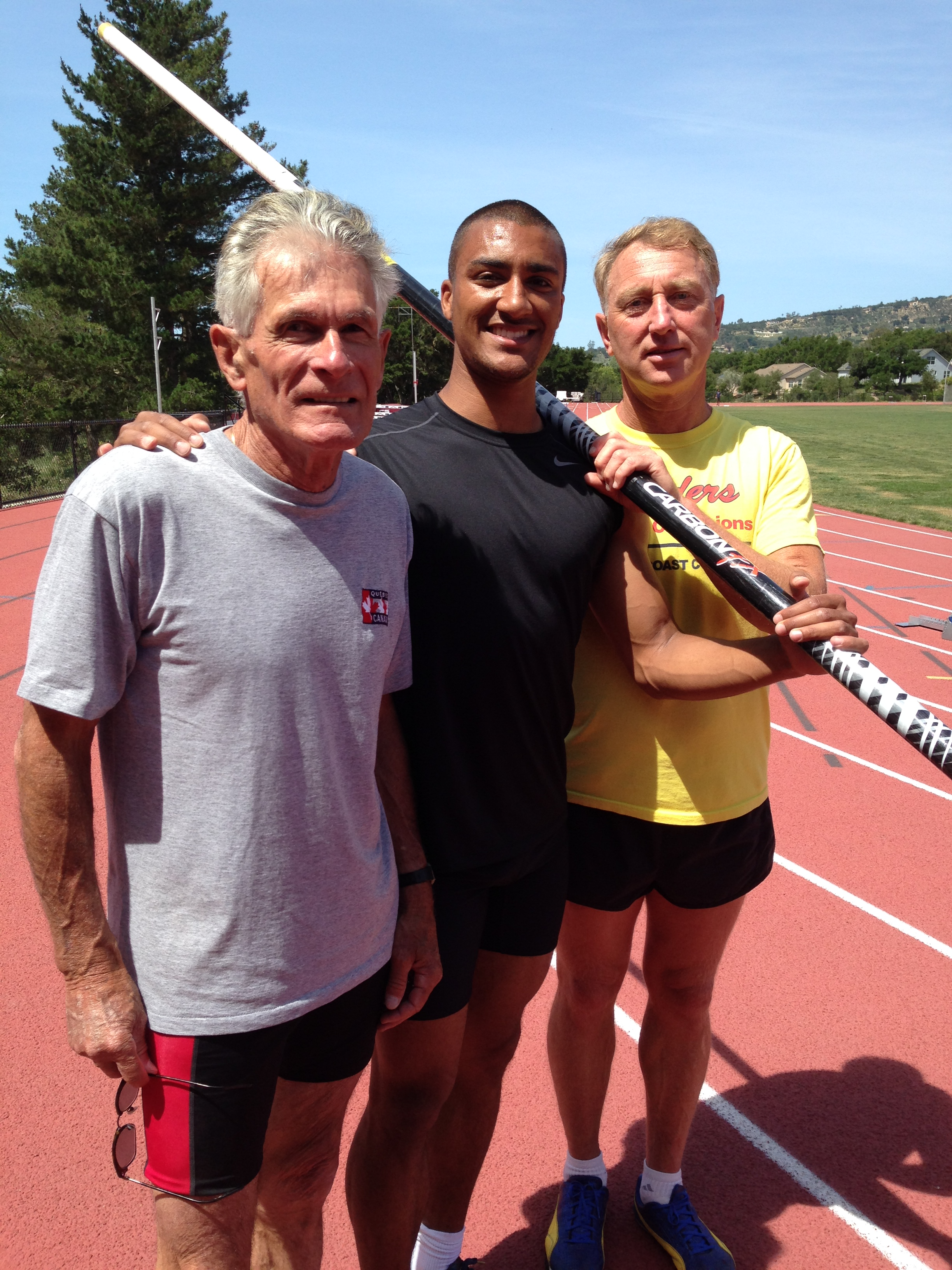 Tom Woodring, 77, left, and Victor Berezovskiy, 54, right, with Ashton Eaton