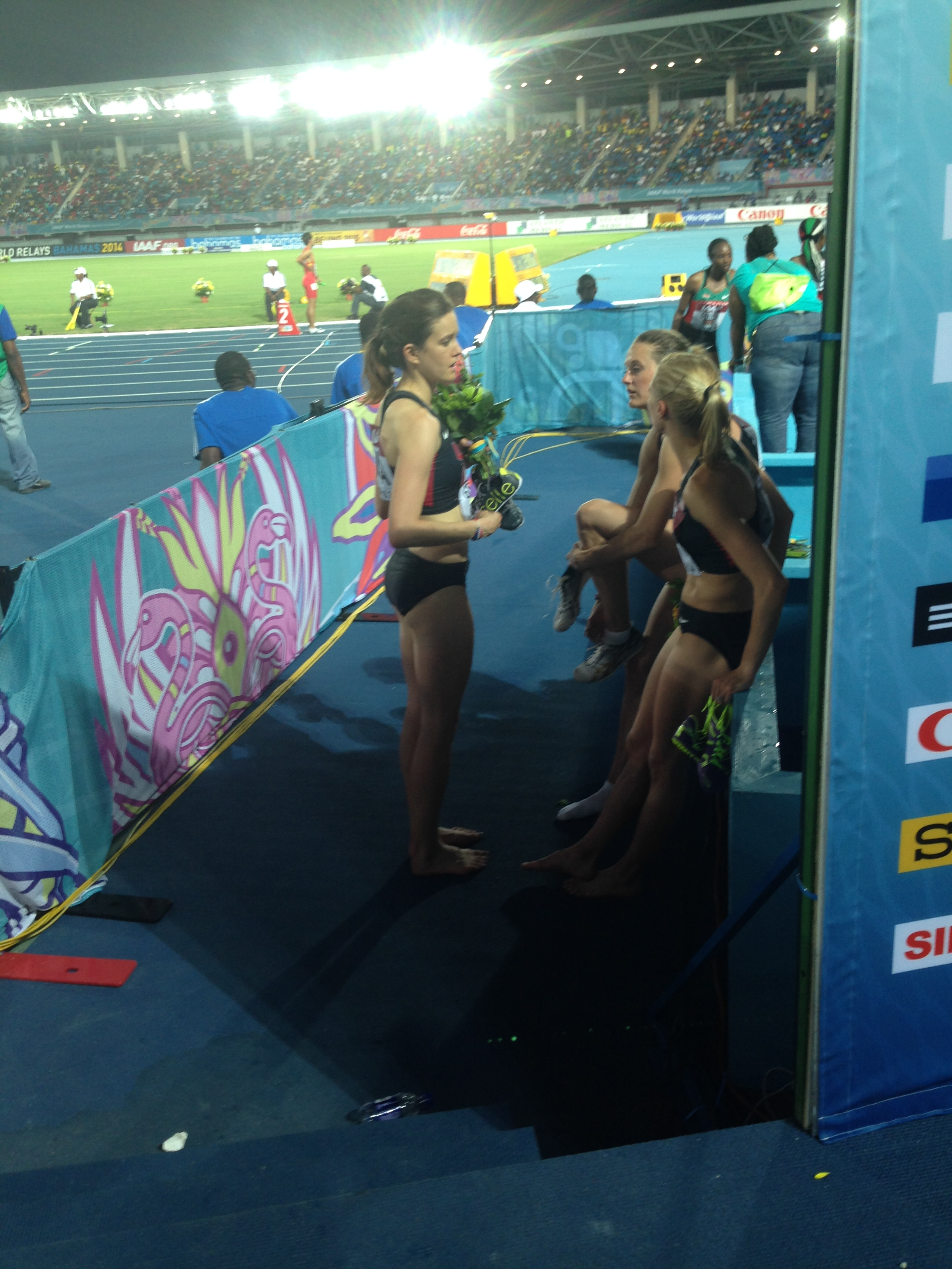 Three of the four U.S. 4x1500 racers seeking a quiet moment after the race