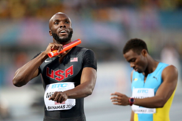 LaShawn Merritt, left, after winning the men's 4x400 relay, holding off Michael Mathieu // photo Getty Images