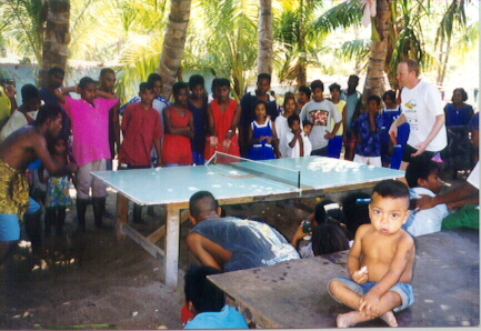 Glenn Tepper running a table tennis clinic in Kiribati in xxxx. In the foreground is 4-year-old xxx // photo courtesy Glenn Tepper