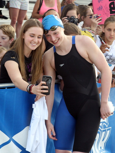 Katie Ledecky, right, with a fan at the Mesa Grand Prix earlier this year // photo Getty Images