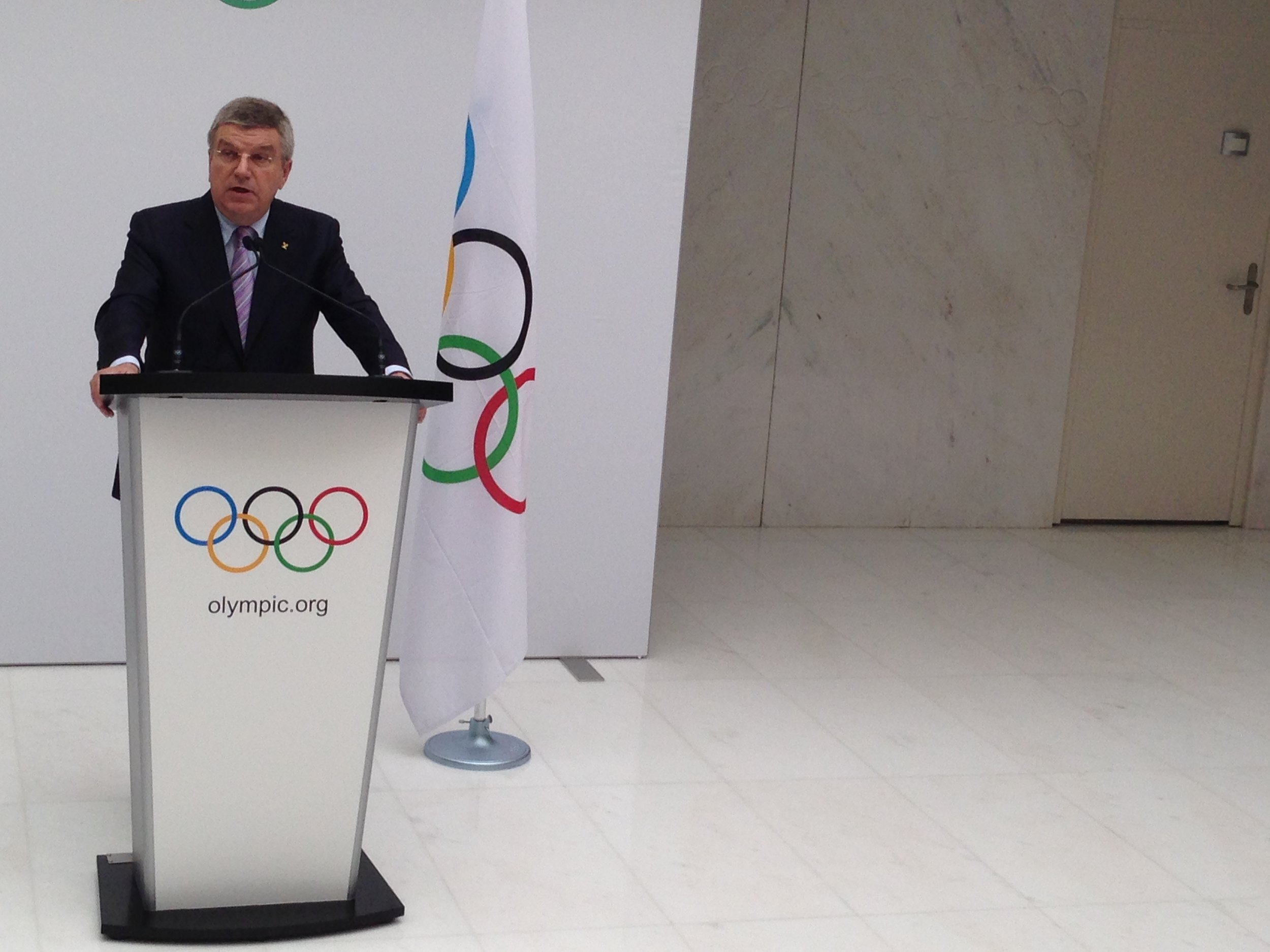 IOC President Thomas Bach announcing the three 2022 candidate cities