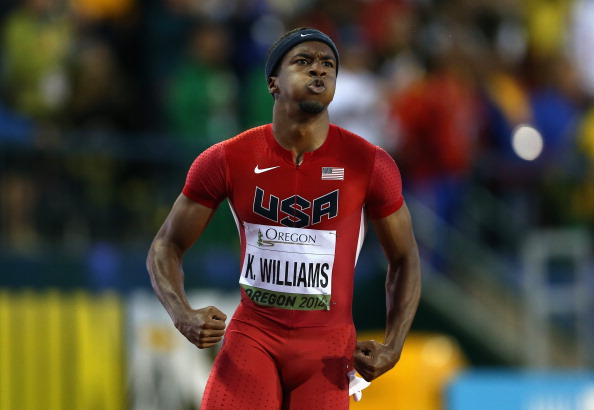 Kendal Williams crossing the finish line to win the men's 100 at the 2014 world juniors // photo Getty Images