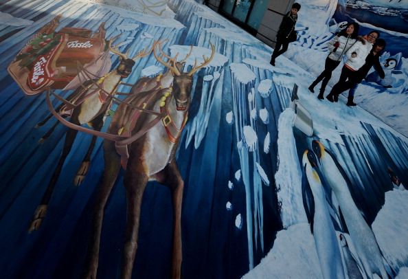 Chinese shoppers walk by a 3D mural outside a Beijing mall -- the Beijing capital, which staged the 2008 Summer Games, now one of three 2022 Winter bid cities // photo Getty Images