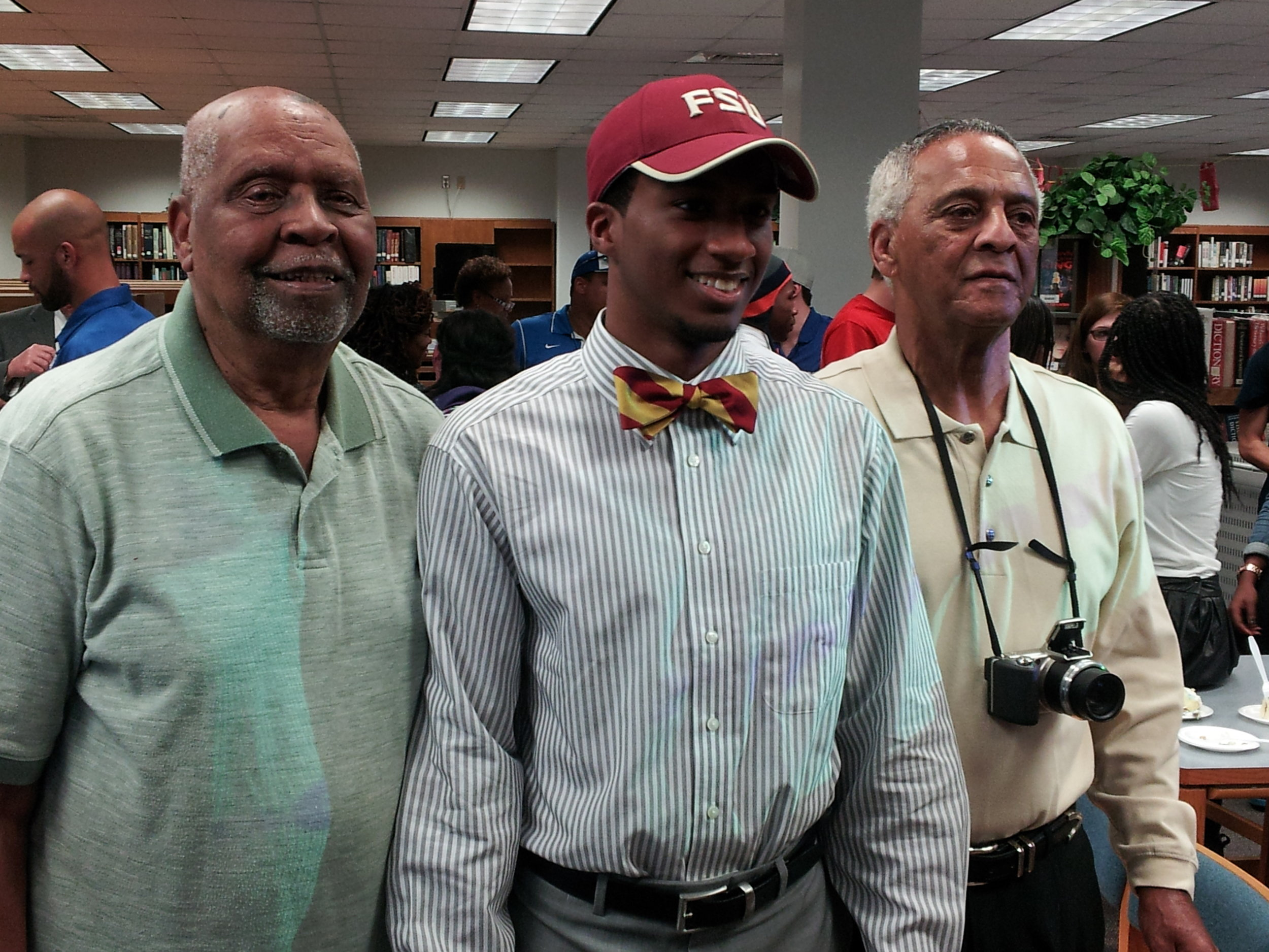 Kendal Williams on Florida State signing day, flanked by grandfathers James Williams and Langston Austin // photo courtesy Williams family