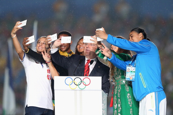 Young athletes taking a selfie with IOC president Thomas Bach at the Youth Olympic Games opening ceremony // photo Getty Images