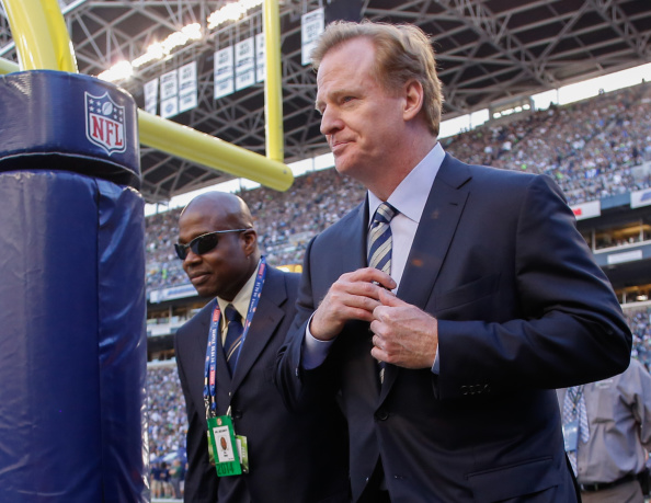 NFL commissioner Roger Goodell, right, on the field in Seattle before the first regular-season game of the year -- four days before TMZ posted the elevator video of Ray Rice and his then-fiance // photo Getty Images
