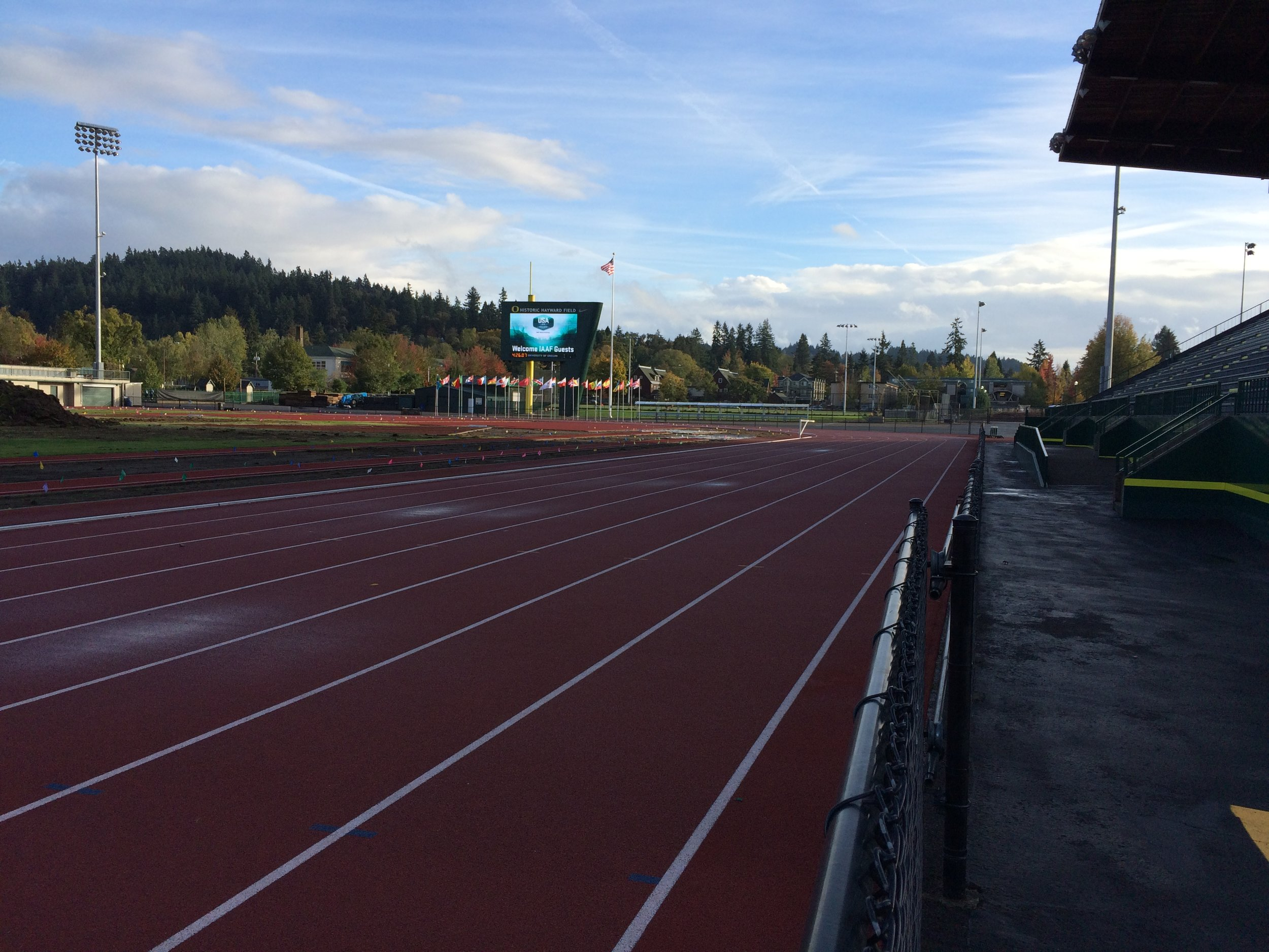 "Welcoming IAAF guests at ""iconic"" Hayward Field. The rain stopped. Blue skies. Omen?"