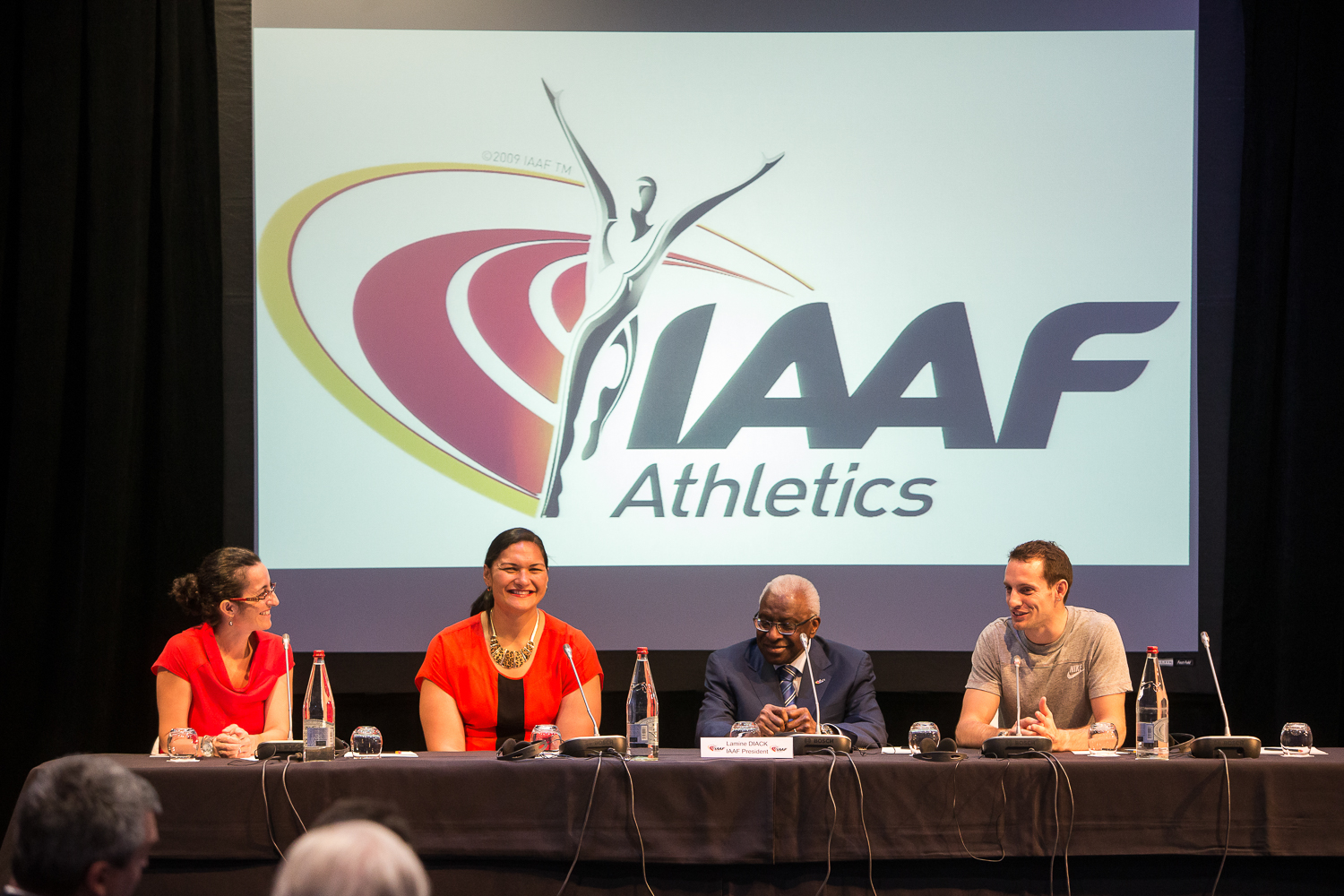 Announcing the IAAF athlete of the year awards, left to right: IAAF press deputy Laura Arcoleo, New Zealand shot-putter Valerie Adams, IAAF president Lamine Diack, French pole-vaulter Renaud Lavillenie // photo courtesy IAAF